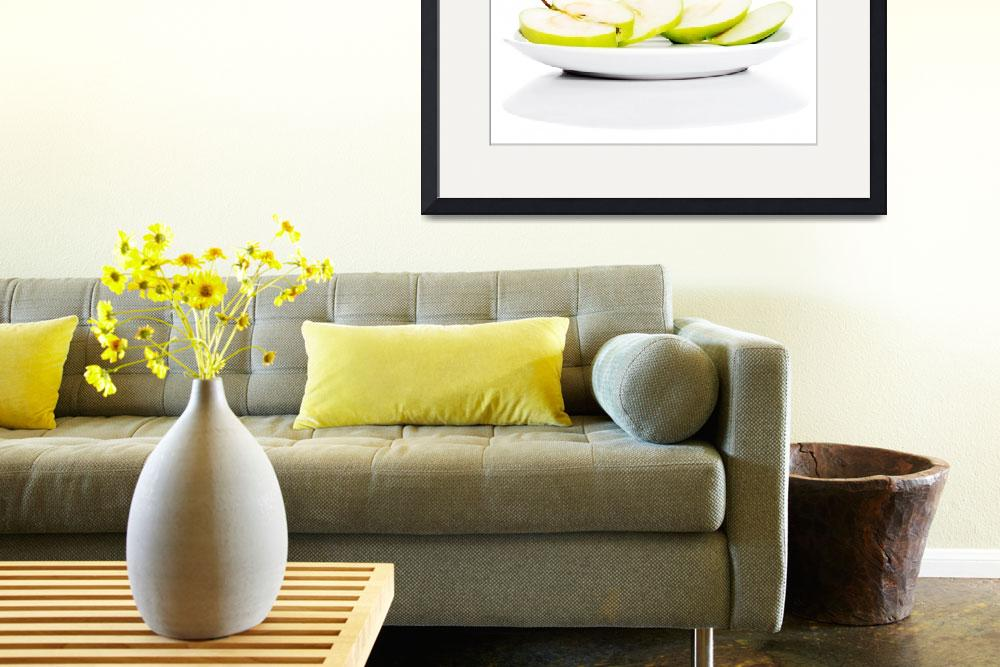 """""""Green apples divided on two half. Isolated on whit""""  by Piotr_Marcinski"""