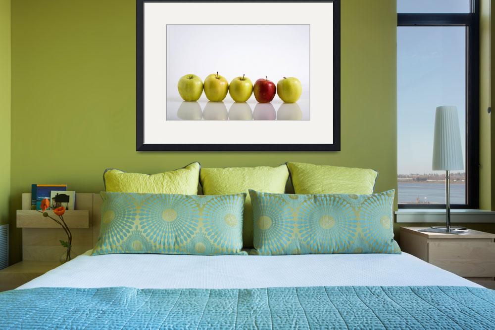 """Four Yellow Apples With One Red Apple In A Row&quot  by DesignPics"
