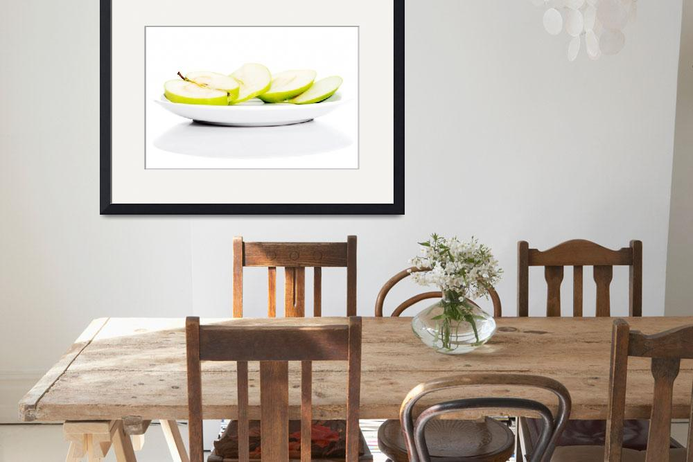 """Green apples divided on two half. Isolated on whit""  by Piotr_Marcinski"