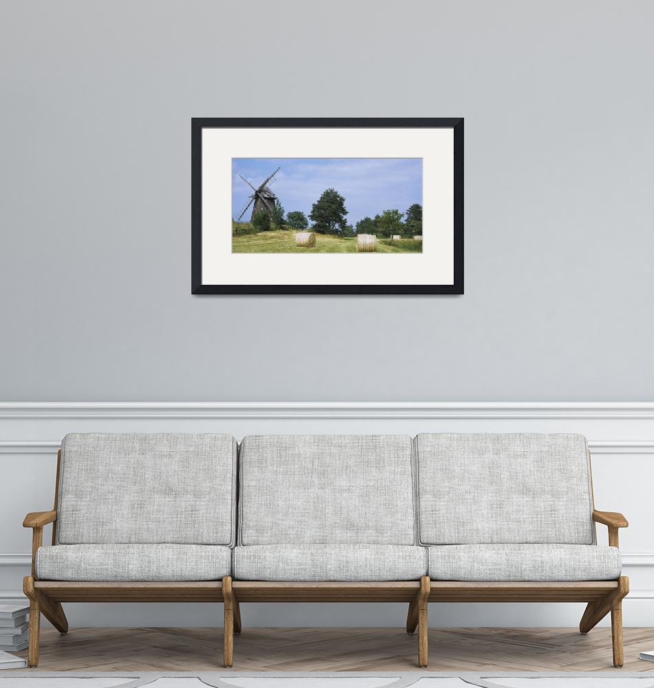 """""""Hay bale in a field with a traditional windmill i""""  by Panoramic_Images"""