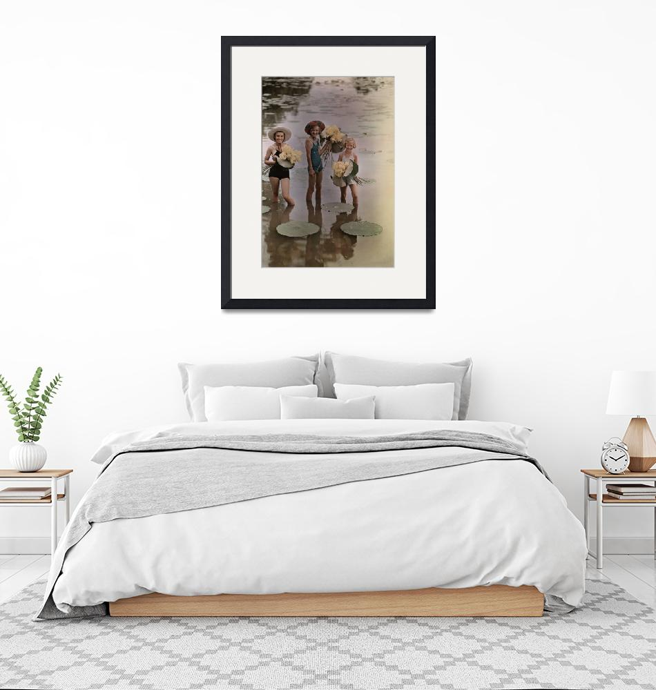 """Amana girls standing in water holding bunches""  by fineartmasters"