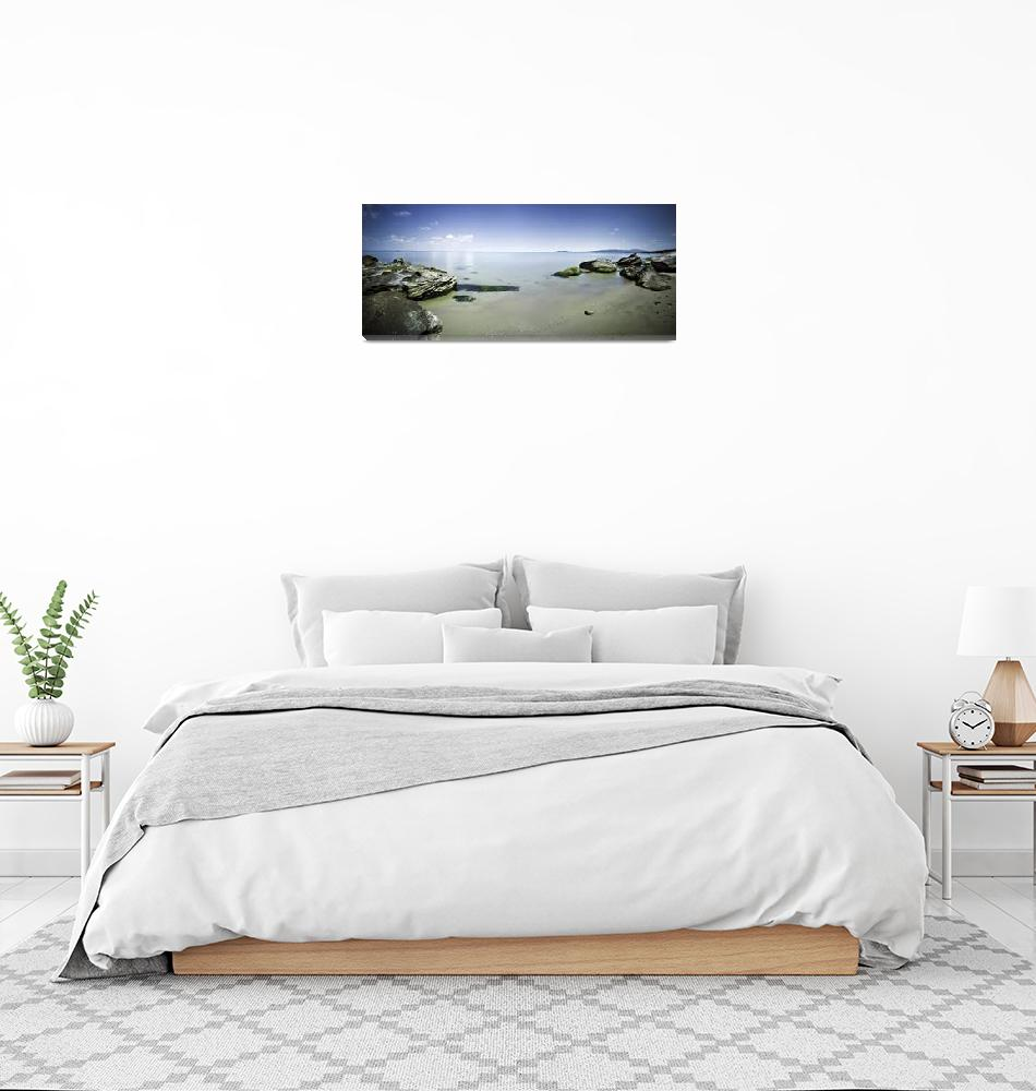"""""""Panoramic view of tranquil sea and boulders agains""""  by stocktrekimages"""
