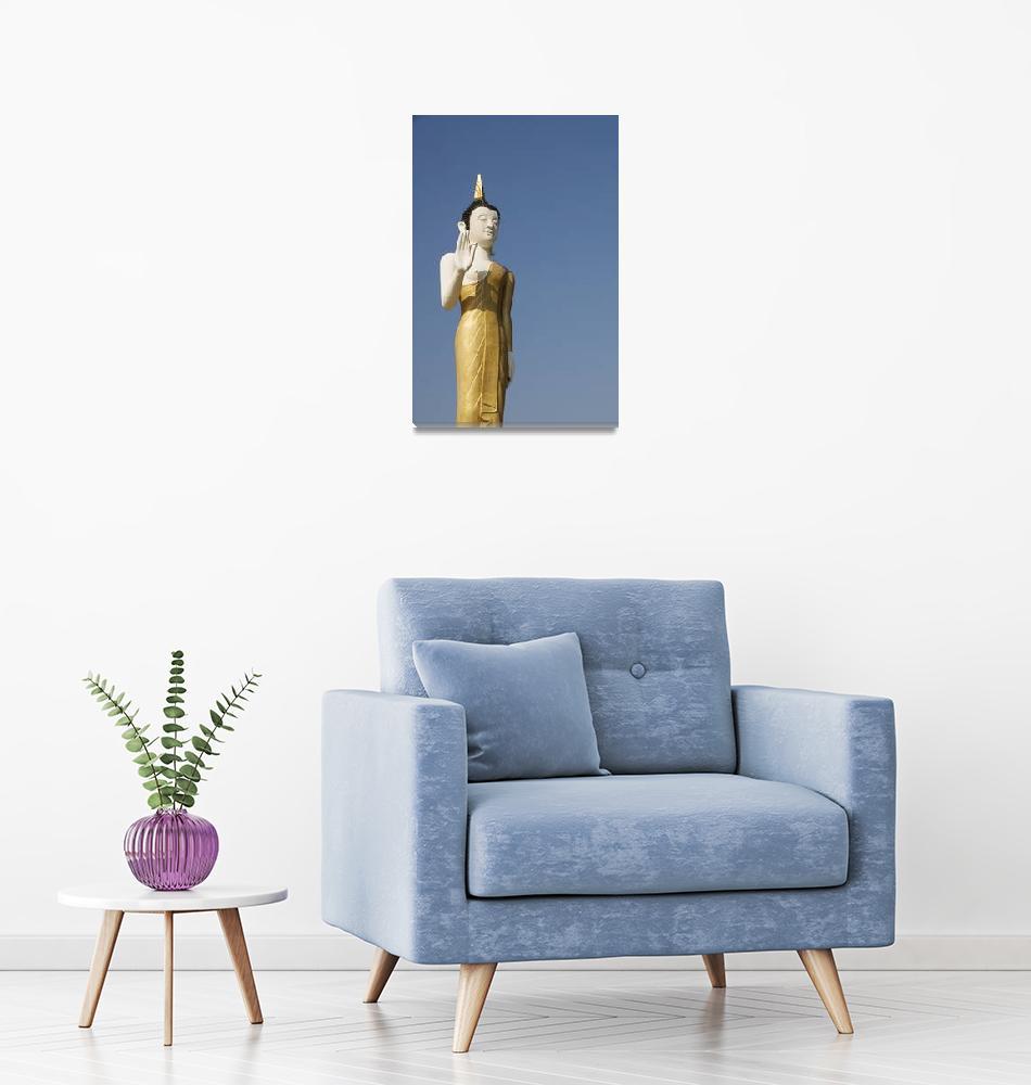 """Laos, Vientiane, Wat That Luang Neua, Buddha statu""  by DesignPics"