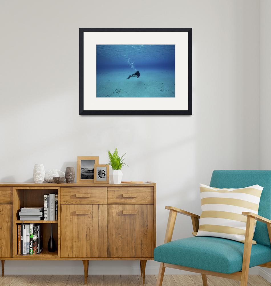 """""""A diver on a scooter explores the clear blue water""""  by stocktrekimages"""