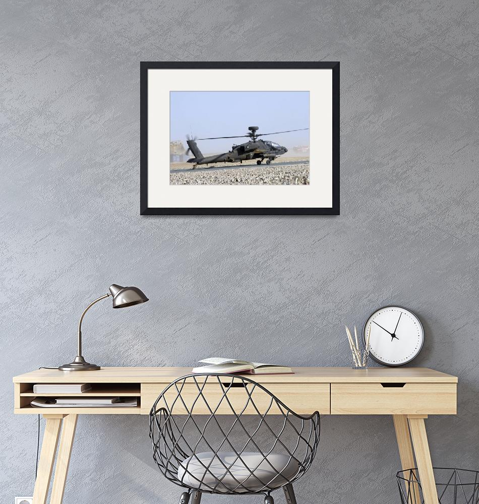 """""""An Apache helicopter prepares for takeoff at Camp""""  by stocktrekimages"""
