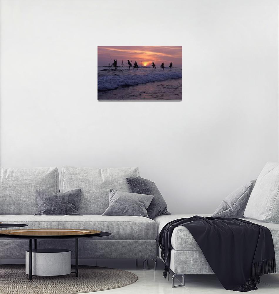 """""""Stilt Fishermen Silhouetted At Sunset Sri Lanka,""""  by DesignPics"""