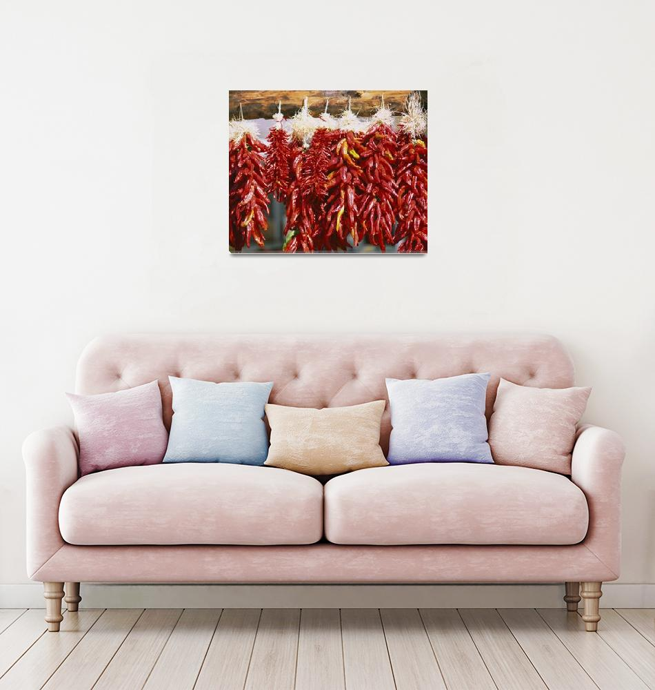 """Red chili peppers hanging on a log""  by Panoramic_Images"