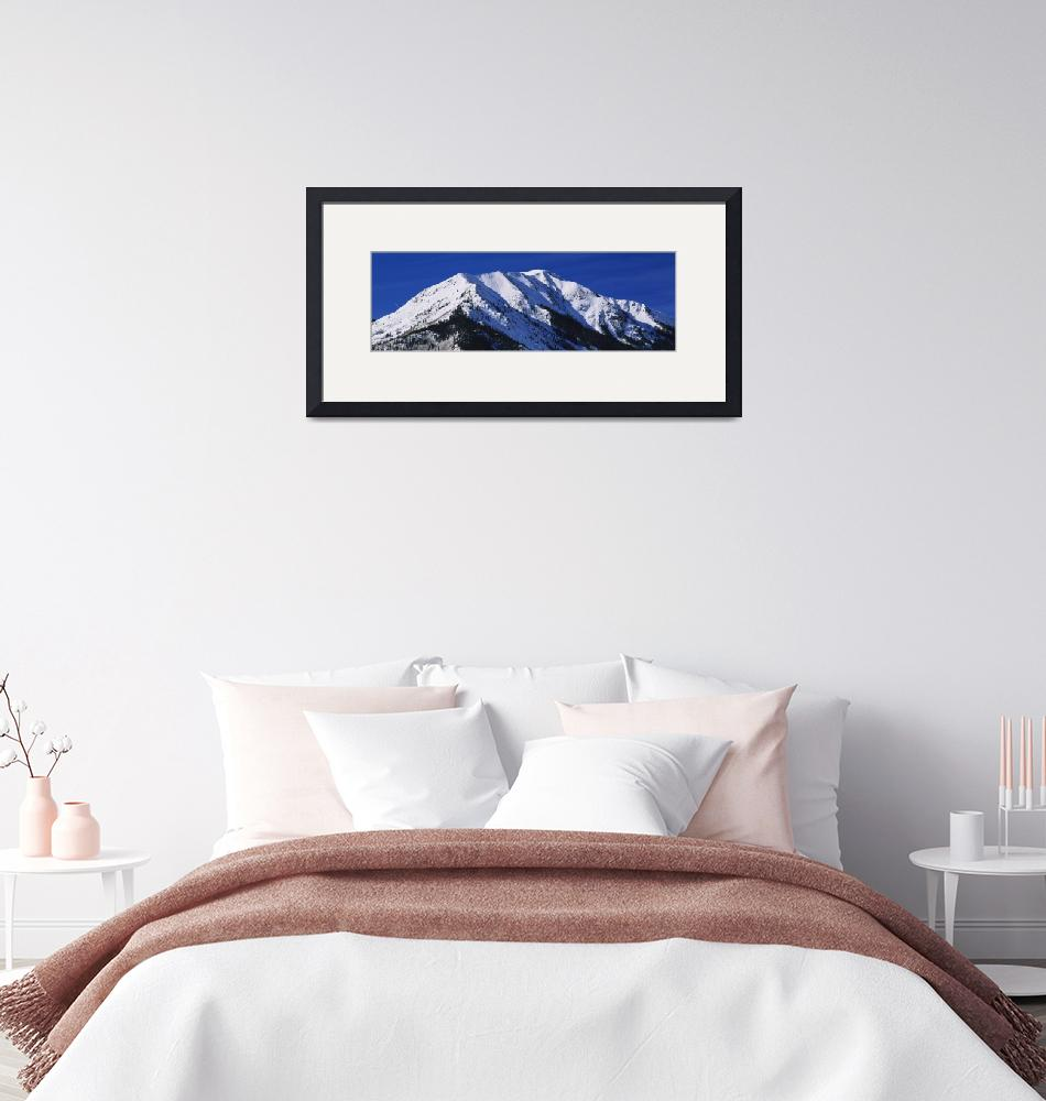 """""""Low angle view of a snow covered mountain""""  by Panoramic_Images"""