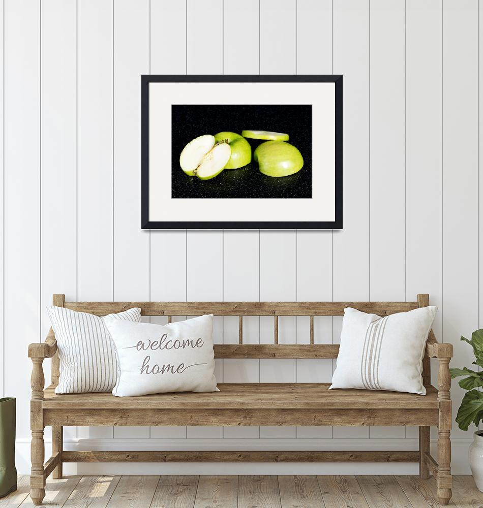 """Green apples cut into two. Over black background.""  by Piotr_Marcinski"