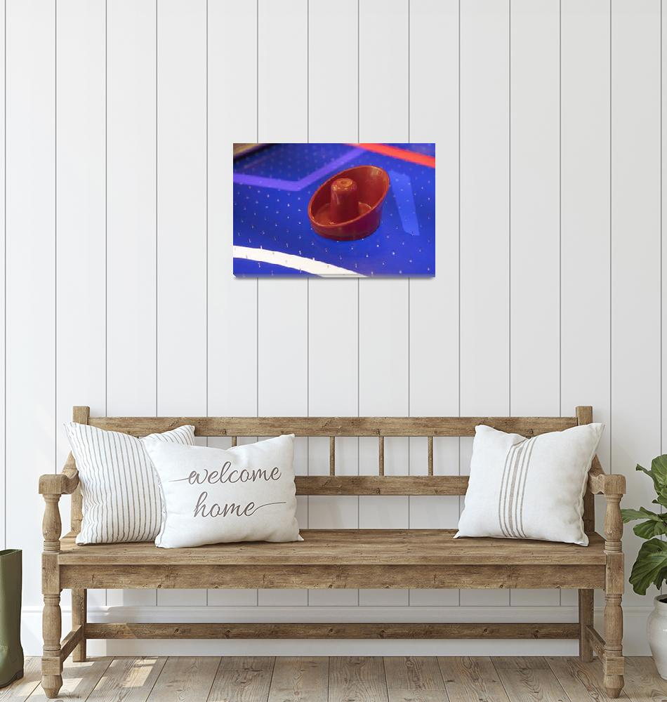 """""""Red Air Hockey Paddle On Blue Table""""  (2017) by johnmclenaghan"""