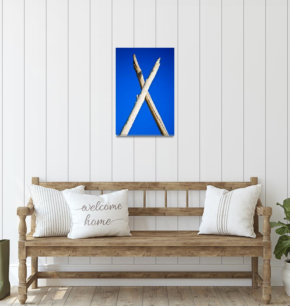 """Cross of the logs on blue sky background""  by RomanPopov"