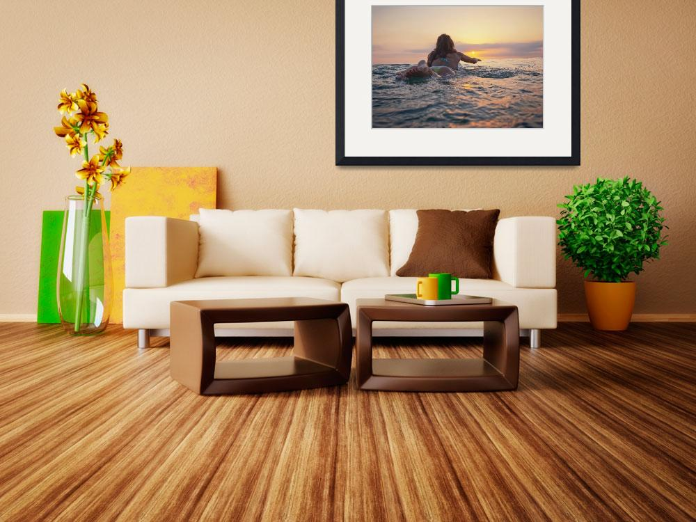 """A Woman Laying On A Surfboard Watching The Sunset,""  by DesignPics"
