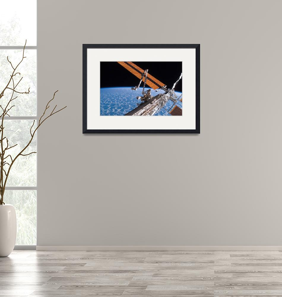 """The Canadarm2 and solar array panel wings on the I""  by stocktrekimages"