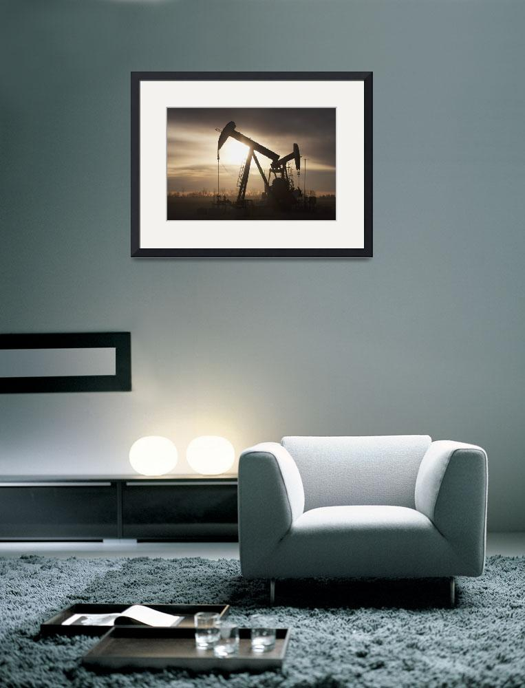 """""""Silhouette Of Two Pump Jacks At Sunrise With Cloud&quot  by DesignPics"""