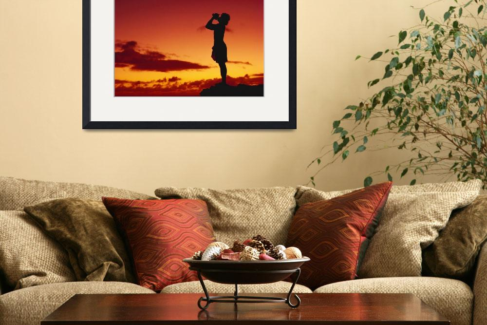 """""""Hawaii, Conch Shell Blower Silhouetted By Orange A""""  by DesignPics"""
