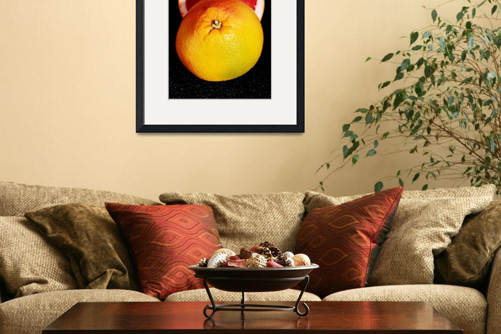 """""""Fresh grapefruit divided into two pieces. On black&quot  by Piotr_Marcinski"""