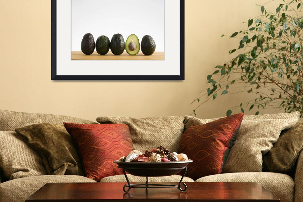 """""""A Row Of Avocados With Interior Of One Showing Sta&quot  by DesignPics"""