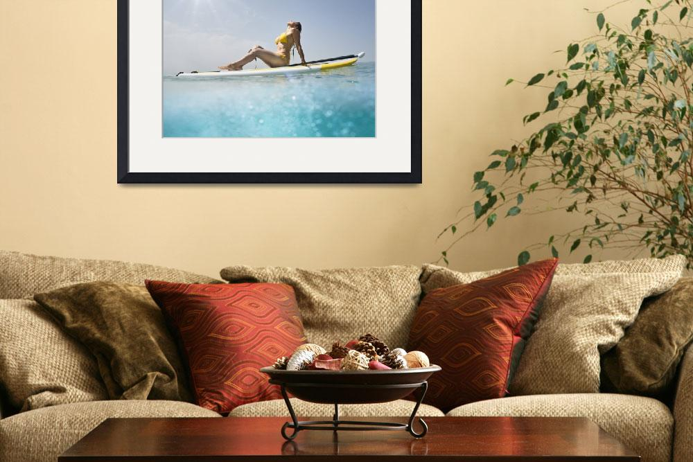 """""""Woman sits with her paddle and board basking in th&quot  by DesignPics"""